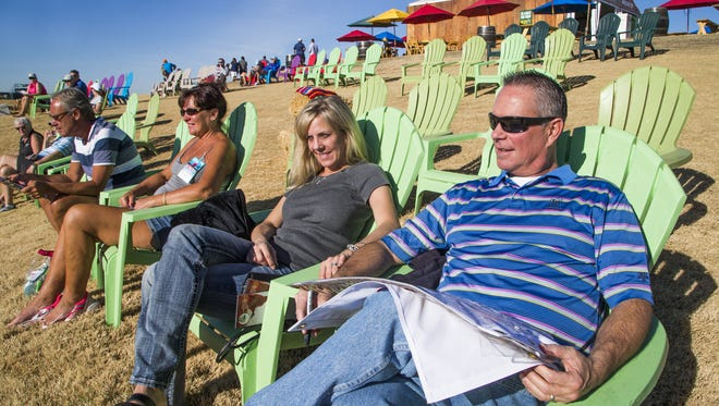 Enjoying the beautiful weather, John and Jennifer Miller, Sun City, left, and Teri and Bill Hosmer, Scottsdale, relax at the 12th hole during the Annexus Pro-Am at the 2018 Waste Management Phoenix Open at TPC Scottsdale, Wednesday, January 31, 2018.