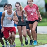 North Fort Myers cross country runnner Kayla Easterly runs the stairs with teammates during practice on Thursday.