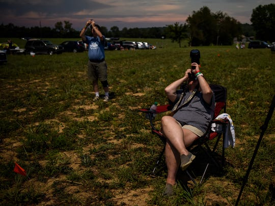Laurel Cull (right) and her husband David Cull of Katy, Texas, take pictures as the solar eclipse reaches totality at  Orchardale Farm in Cerulean, Ky., on Monday, Aug. 21, 2017. The next total solar eclipse visible from North America will be April 8, 2024.