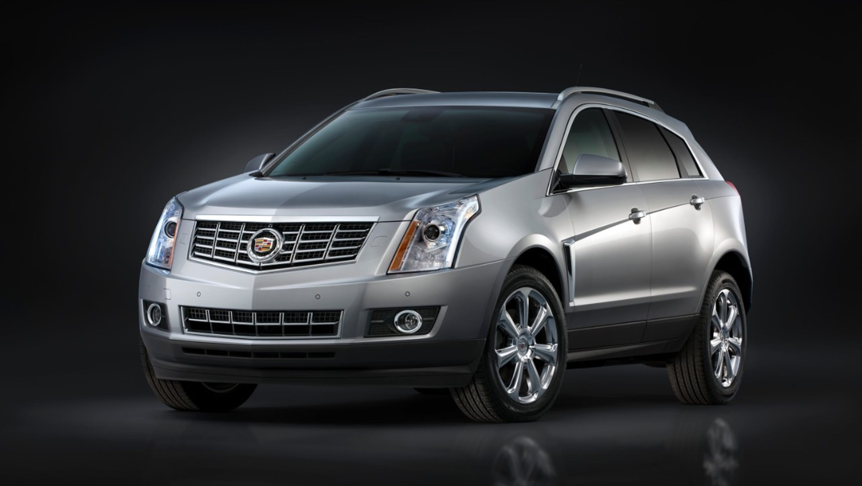 cadillac reviews srx rear autoweek notes premium suv article car collection review