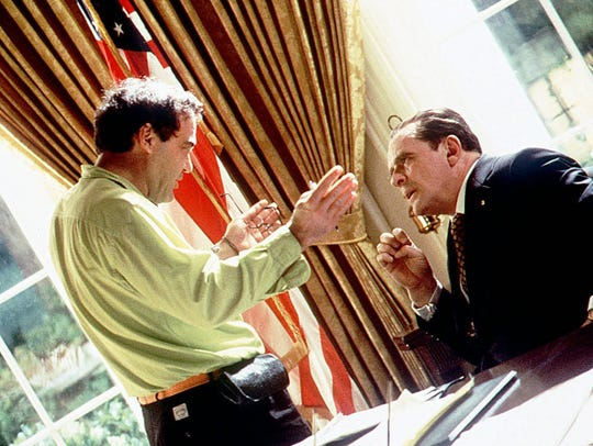 Oliver Stone on the set of 1995's 'Nixon' with star