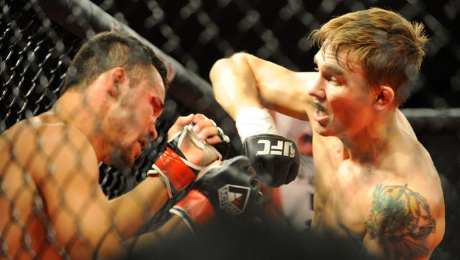 Visalia's Cody Gibson elbows Oakdale's Rolando Velasco fight during Tachi Palace Fights 27 at the Tachi Palace Hotel and Casino in Lemoore on Thursday, May 19, 2016.
