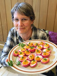Judy Flegel's deviled eggs are pink from pickling in