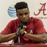 Former Alabama basketball player Retin Obasohan, of Belgium, reacts during a neews conference about the attacks in Brussels, on Tuesday in Tuscaloosa.