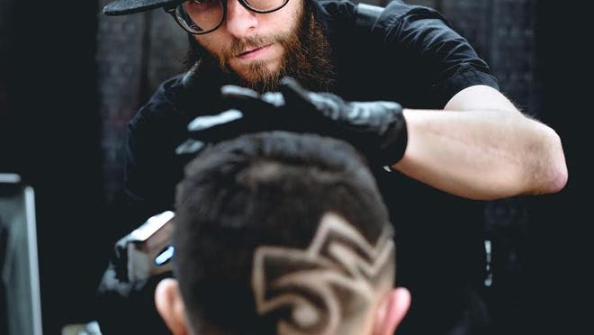 Seth Izzard (pictured) is the owner of Izzy'z Barbershop, which moved to 402 W. Main St. in downtown Ionia in Dec. 2019.