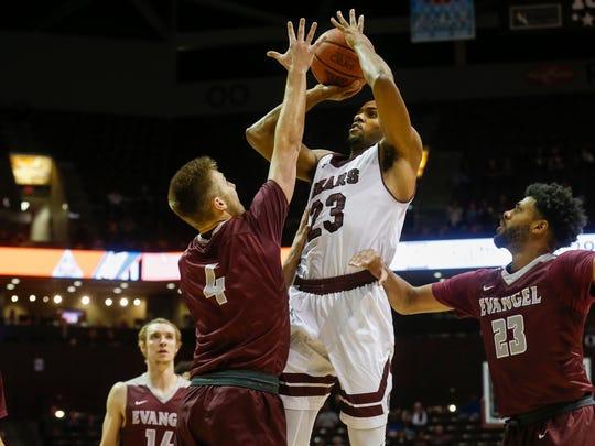 J.T. Miller (23) takes a jump shot over Braden Adams