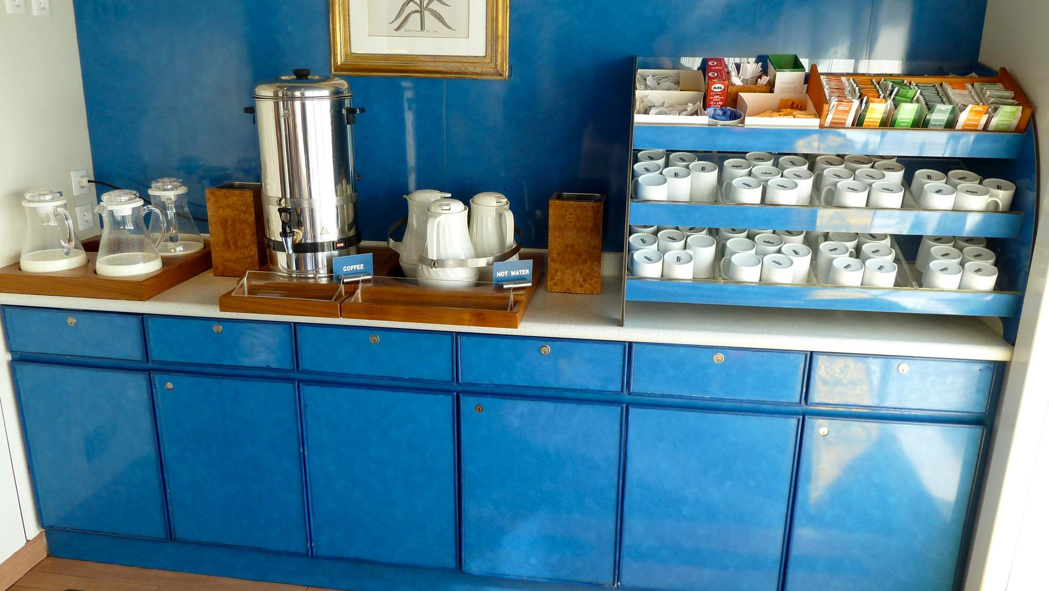 Self-service tea and coffee stations are located on either side of Marcos Restaurant.