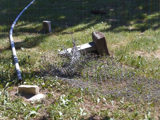 Huston Cemetery, otherwise known as the cemetery in the middle of the road, was hit by a driver June 10 in West Des Moines.