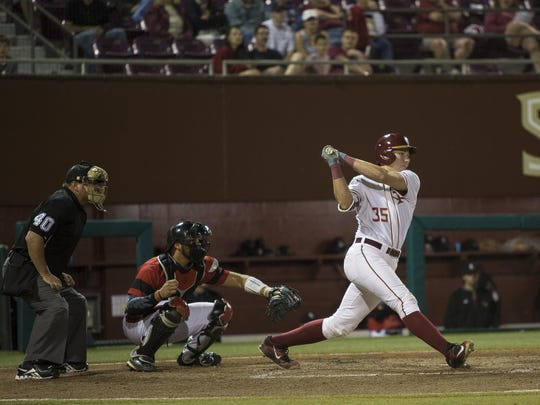 FSU freshman catcher Cal Raleigh blasts a two-run home run in the seventh inning in Friday's 12-7 comeback victory over No. 4 Louisville.