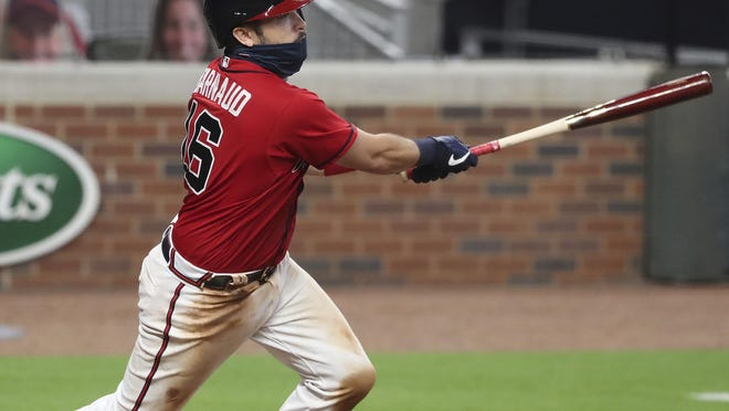 Braves catcher Travis D'Arnaud hits a three-RBI double that proves to be the game winner for a 11-10 victory over the New York Mets during the eighth inning on Friday night, July 31, 2020 in Atlanta.