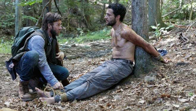 """This image released by A24 Films shows Joel Edgerton, left, and Christopher Abbott in a scene from """"It Comes At Night."""""""