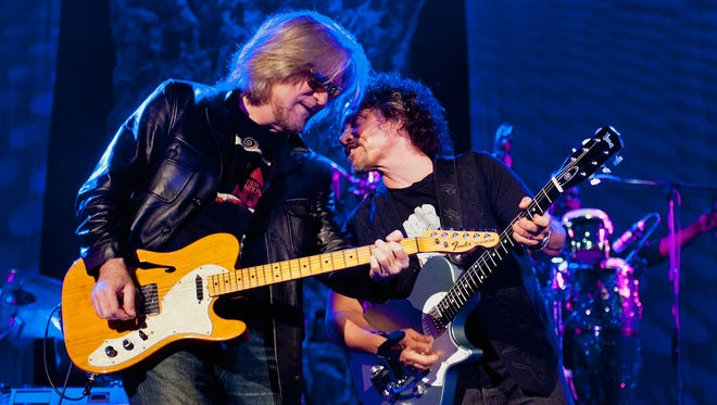 Daryl Hall and John Oates of Hall & Oates perform at the Ryman Auditorium on June 2, 2013 in Nashville, Tennessee.