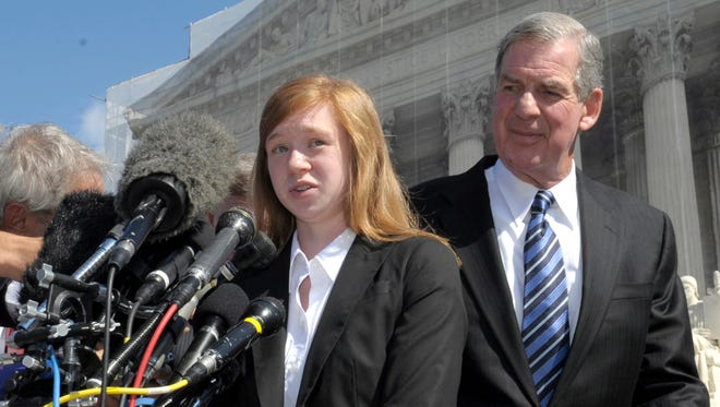 In this Oct. 10, 2012, file photo, Abigail Fisher, the Texan involved in the University of Texas affirmative action case, accompanied by her attorney Bert Rein, talks to reporters outside the Supreme Court in Washington. Consideration of race in college admissions is again in line of fire at the Supreme Court on Wednesday, Dec. 9, 2015, for the second time in three years, in the case of Fisher, a white Texas woman who was rejected for admission at the University of Texas.