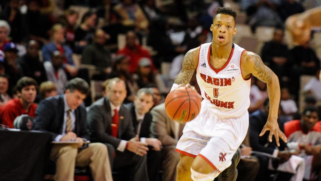 UL point guard Jay Wright moves the ball down the court in Saturday night's win over Troy at the Cajundome.