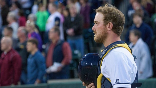 Montgomery Biscuits catcher Justin O'Conner during the national anthem at Riverwalk Stadium in Montgomery, Ala., on Thursday April 6, 2017.