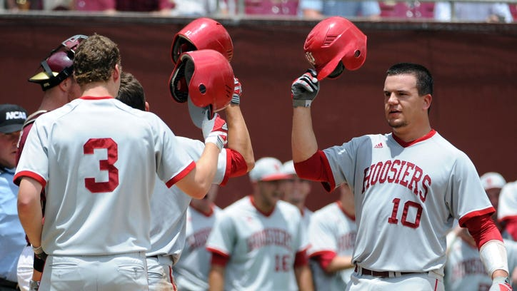 FILE - Hoosiers' Kyle Schwarber (10) celebrates with teammates after a home run in the game against the Florida State Seminoles during the Tallahassee super regional of the 2013 NCAA baseball tournament at Dick Howser Stadium.