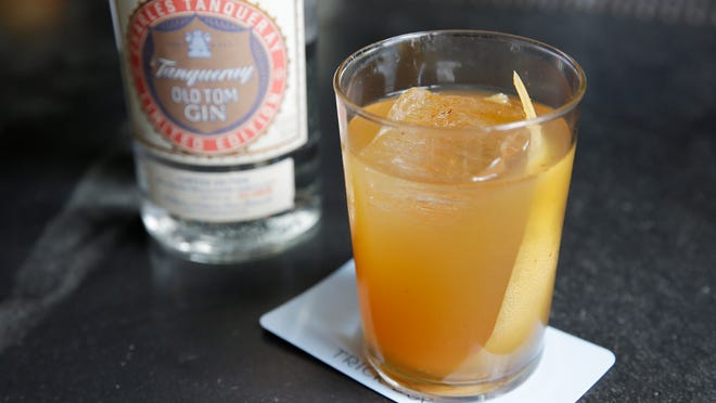 This Tuesday, Aug. 19, 2014, photo shows a cocktail called a Cup of Punch made with Old Tom Gin at the Trick Dog bar in San Francisco. Almost extinct, Old Tom has been getting a new lease on life as part of the overall rise of gin and the resurrection of classic cocktails.