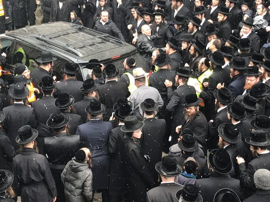 As snow swirled, the body of Rabbi Mordechai Hager was taken out of the yeshiva, in a crush of mourners, and placed in a Toyota minivan in Kaser on Friday, March 16, 2018.