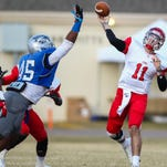 Co-Lin's Deion Pope (45) puts the pass rush on then-East Mississippi quarterback Chad Kelly (11) during the Mississippi junior college state championship in Wesson last season.