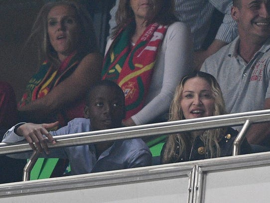 Madonna and son David Banda (left) watch the World