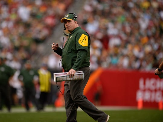 Green Bay Packers head coach Mike McCarthy shows his