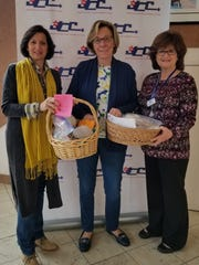 From left: Barbara Muhlgeier, JCCMC president; Lenore Grubman of the JFK Auxiliary; and Diane Mael, JCCMC director of Adult Services.