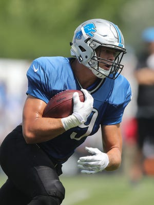 Detroit Lions tight end Cole Wick catches passes during training camp July 31, 2016, in Allen Park.