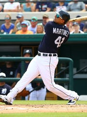 Tigers designated hitter Victor Martinez (41) bats during the second inning of the Tigers' 4-2 exhibition loss on Monday, March 19, 2018, in Lakeland, Fla.