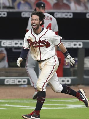 Atlanta Braves' Dansby Swanson celebrates his two-run home run against the Washington Nationals during the ninth inning of a baseball game Monday, Aug. 17, 2020, in Atlanta.
