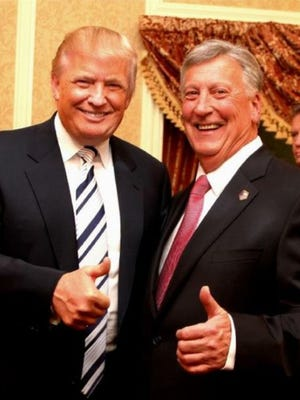 Donald Trump and Dutchess County Sheriff Butch Anderson pose for a photo after Anderson is sworn in as sheriff.