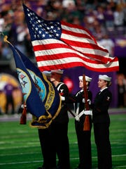 Color guard from the Navy presents the flag during