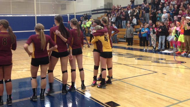 Luxemburg-Casco seniors Sarah Kinnard and Brooke Bertrand (No. 4) embrace following the Spartans' loss against Waupun in a WIAA Division 2 sectional final volleyball match on Nov. 1, 2014.
