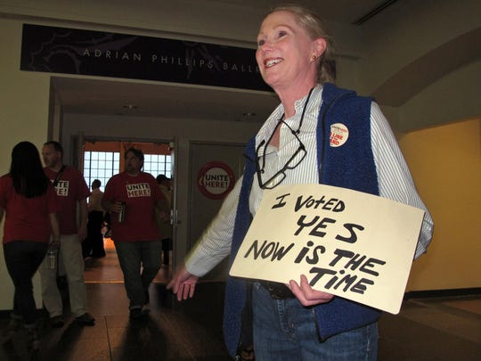 Ruthann Joyce directs members of Local 54 of the Unite-HERE union to a voting room on June 16 in Atlantic City, as the union decideds whether to authorize a strike against Bally's, Caesars, Harrah's, Tropicana casinos. The union has authorized a strike against the Trump Taj Mahal.
