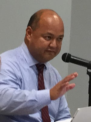 Superintendent Jon Fernandez gestures as he addresses the meeting of the Guam Education Board Tuesday Aug. 22, 2017.