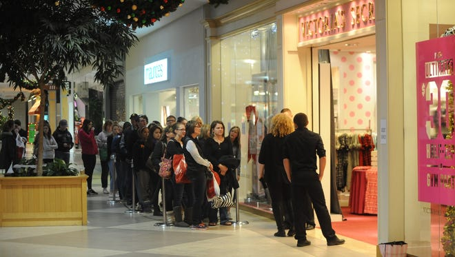 Black Friday shoppers wait outside Victoria's Secret early Friday morning in Richmond Square Mall.