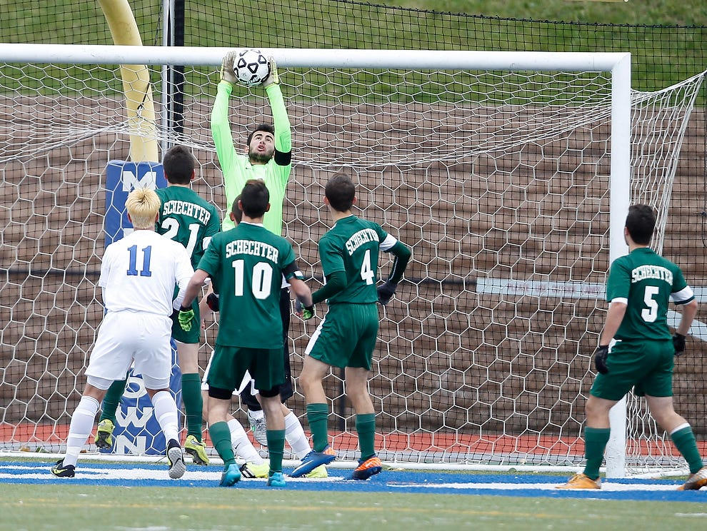 Solomon Schechter goalie Noah Dunn (1) pulls in a high shot during their 1-0 win over Geneseo in the NYSPHSAA Class C state semifinal soccer game at Middletown High School on Saturday, Nov. 14, 2015.