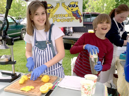 First-season Shelburne Farmers Market vendors, Lemon Power Lemonade, Jane Lindsley, 13, and her younger brother Ray, 10, are saving for college.