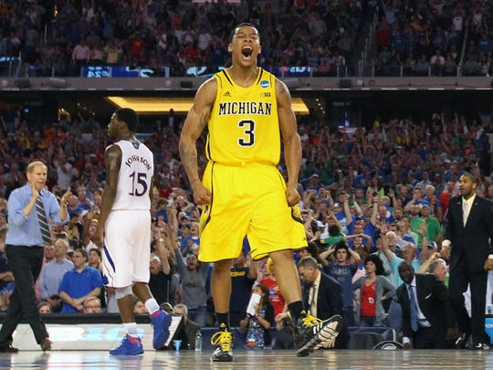 Michigan Wolverines guard Trey Burke (3) reacts after