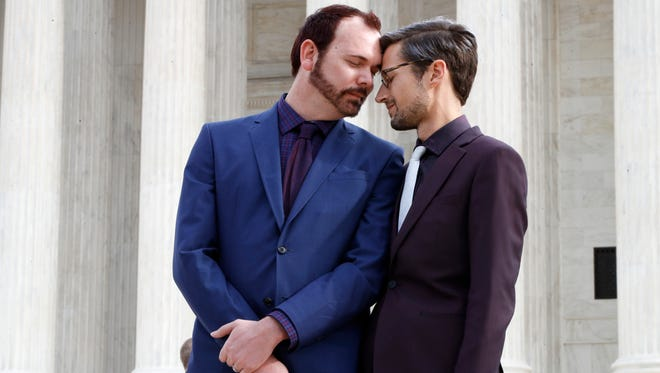 In this Dec. 5, 2017 file photo, Charlie Craig, left, and David Mullins touch foreheads after leaving the Supreme Court in Washington. On June 4, 2018, the Supreme Court ruled in favor of a baker who wouldn't make a wedding cake for the same-sex couple.