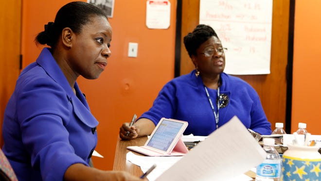 """Andrea Coddett, assistant superintendent for instruction K-12 at East Ramapo Central School District, left, and Principal Astrid Johnson participate in a debriefing after observing teachers at Eldorado Elementary School, Jan. 14, 2014 in Chestnut Ridge. A group of administrators observed teachers in their ability to foster """"student engagement"""" as they use the state's new education standards, a.k.a., the Common Core."""
