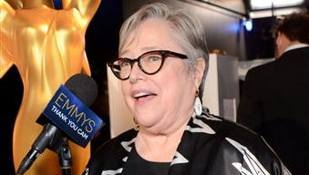 Kathy Bates speaks backstage after receiving the award for outstanding supporting actress in a miniseries or a movie for their work on ?American Horror Story: Coven? at the 66th Primetime Emmy Awards at the Nokia Theatre L.A. Live on Monday.