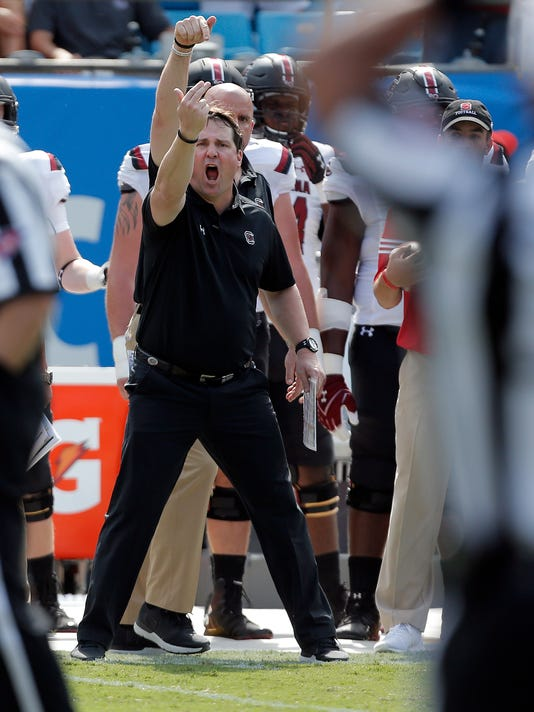 South Carolina head coach Will Muschamp signals for the referee as he wants to argue a call that goes North Carolina State's way during the first half of an NCAA college football game in Charlotte, N.C., Saturday, Sept. 2, 2017. South Carolina won 35-28. (AP Photo/Bob Leverone)