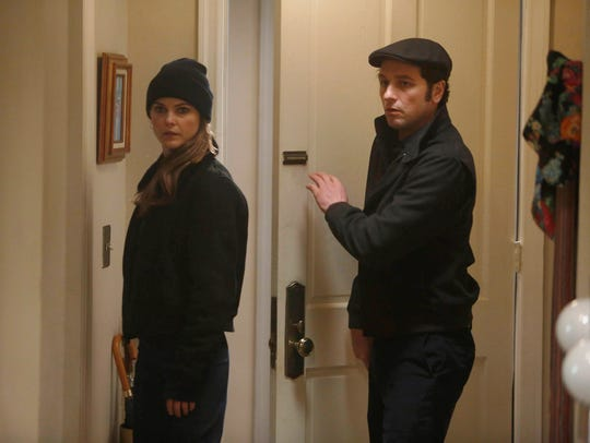 "Keri Russell and Matthew Rhys, as Elizabeth and Philip Jennings on FX's ""The Americans,"" are on a joint mission in the series' Season 2 finale."