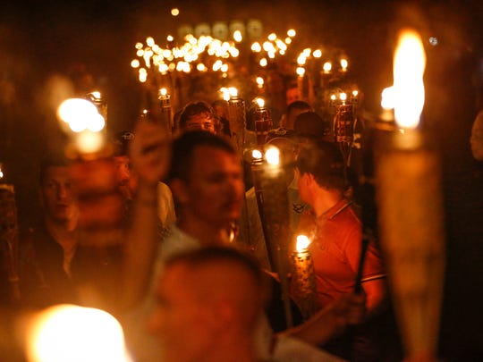 "Multiple white nationalist groups march with torches through the University of Virginia campus in Charlottesville, Va., on Friday, August 11, 2017. The chanted, ""Jews will not replace us."""