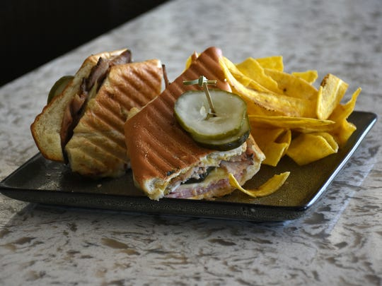 "Signature food items in the hotel's flagship restaurant, rebranded as ""The Deck at 560,"" include the pressed Cubano sandwich. The Hilton Marco Island Beach Resort & Spa's guest rooms will remain closed into February for repair and renovations, but the hotel's meeting areas and restaurants are open for business."