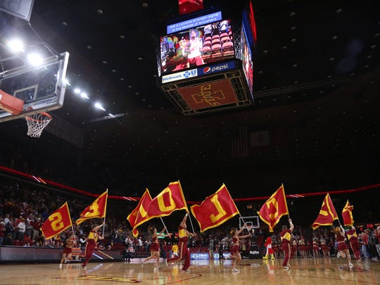 Iowa State cheerleaders fave flags that spell Cyclones