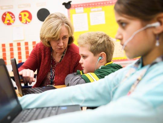 Laura Rewis speaks with third grader Sam Nelson, 9,