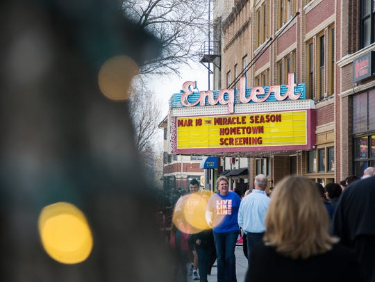 Movie goers fill the Englert Theatre for the hometown
