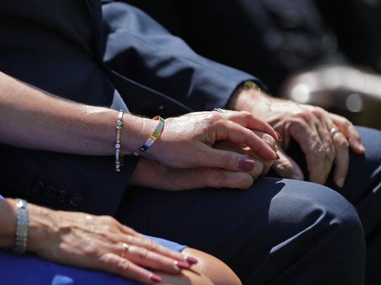 Vice President Mike Pence holds hands with his wife