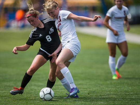 North Polk's Katryn Halterman and Assumption's Abbey